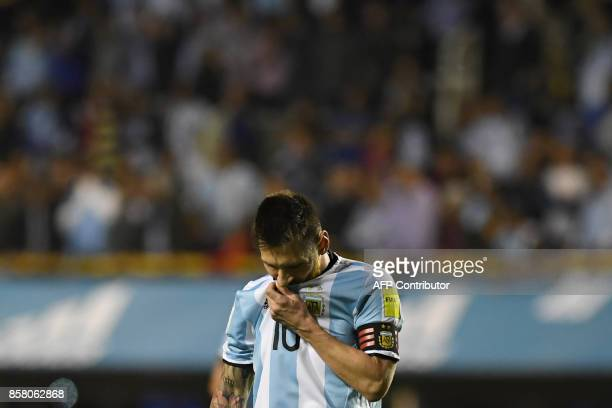 Argentina's Lionel Messi gestures at the end of the goalless 2018 World Cup qualifier football match against Peru in Buenos Aires on October 5 2017 /...