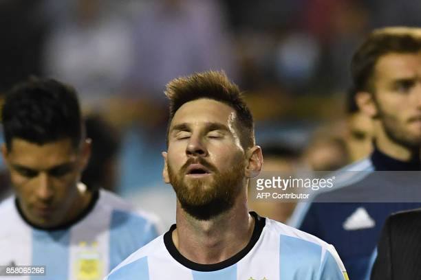 Argentina's Lionel Messi gestures at the end of their 2018 World Cup football qualifier match against Peru in Buenos Aires on October 5 2017 / AFP...