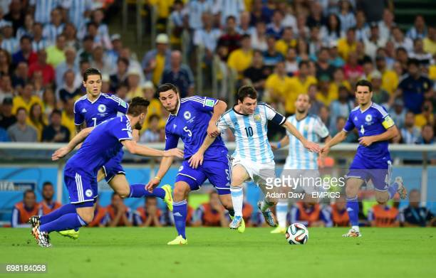Argentina's Lionel Messi holds off Bosnia and Herzegovina's Sead Kolasinac