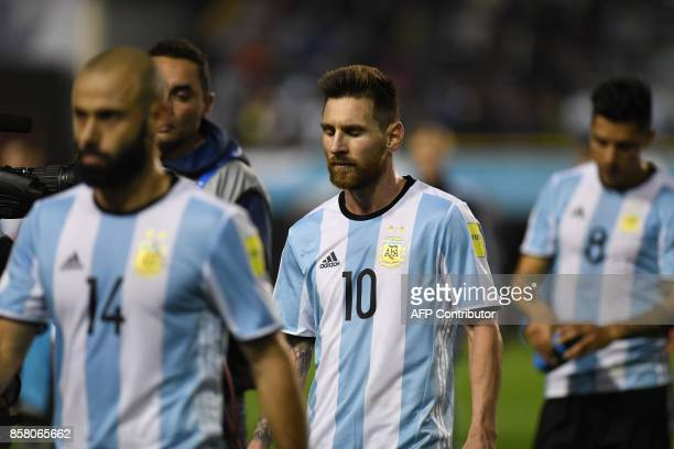 Argentina's Lionel Messi leaves the field in dejection at the end of the goalless 2018 World Cup qualifier football match against Peru in Buenos...