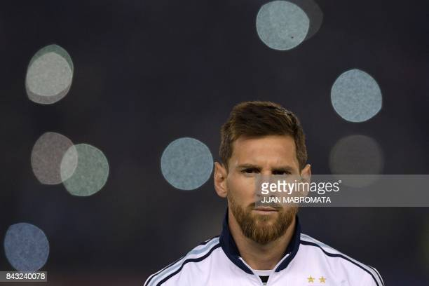 Argentina's Lionel Messi listens to the national anthems before the start of the 2018 World Cup qualifying football match between Argentina and...