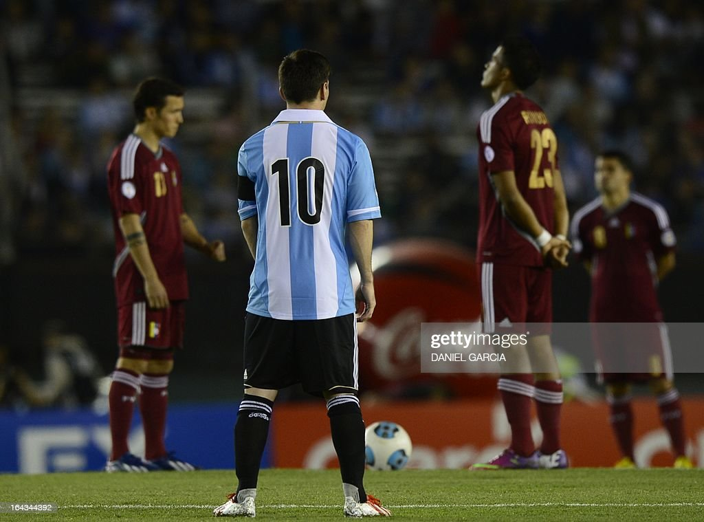 Argentina's Lionel Messi(10) next to Venezuelan midfielder Luis Seijas(L) and Jose Rondon(23) observe a minute's silence in homage of late Venezuelan President Hugo Chavez before the FIFA World Cup Brazil 2014 qualifying match at Monumental stadium in Buenos Aires on March 22, 2013. AFP PHOTO / DANIEL GARCIA