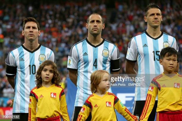 Argentina's Lionel Messi Pablo Zabaleta and Martin Demichelis sing their National Anthem before the kick off
