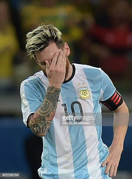 Argentina's Lionel Messi shows his dejection after Brazil's Neymar scored the team's second goal during their 2018 FIFA World Cup qualifier football...