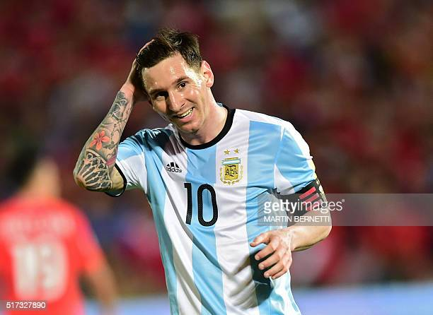 Argentina's Lionel Messi smiles during the Russia 2018 FIFA World Cup South American Qualifiers' football match against Chile in Santiago on March 24...