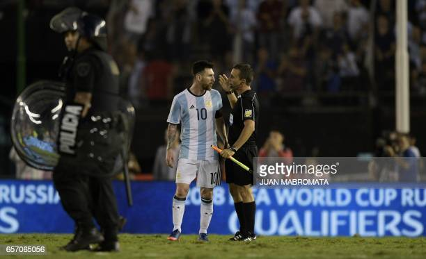 Argentina's Lionel Messi speaks with the linesman during their 2018 FIFA World Cup qualifier football match against Chile at the Monumental stadium...