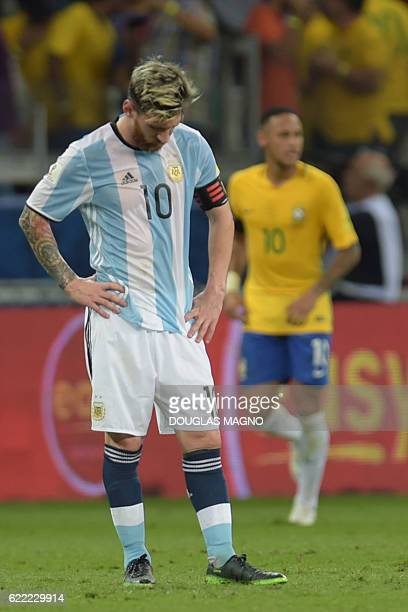 Argentina's Lionel Messi stands in dejection after Brazil's Neymar scored the team's second goal during their 2018 FIFA World Cup qualifier football...
