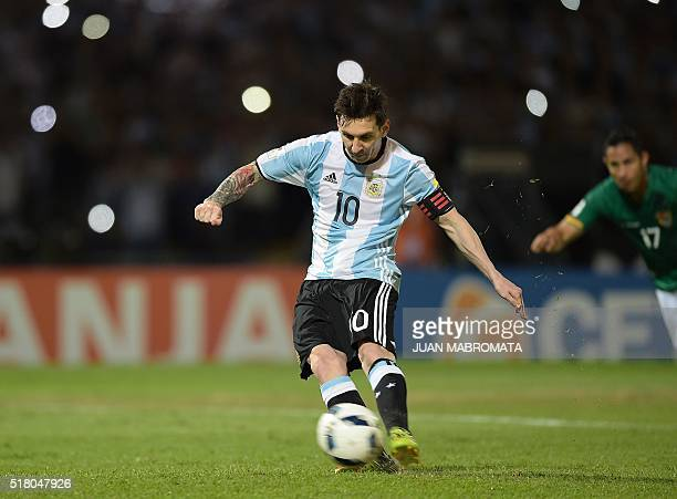 Argentina's Lionel Messi takes a penalty to score against Bolivia during the Russia 2018 FIFA World Cup South American Qualifiers' football match in...
