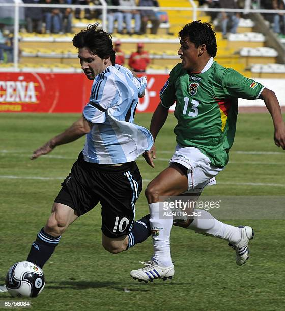 Argentina's Lionel Messi vies for the ball with Bolivia's Abdon Reyes during their FIFA World Cup South Africa2010 qualifying match on April 1st 2009...