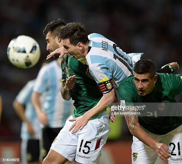 Argentina's Lionel Messi vies for the ball with Bolivia's Danny Bejarano and Bolivia's Ronald Eguino during their Russia 2018 FIFA World Cup South...