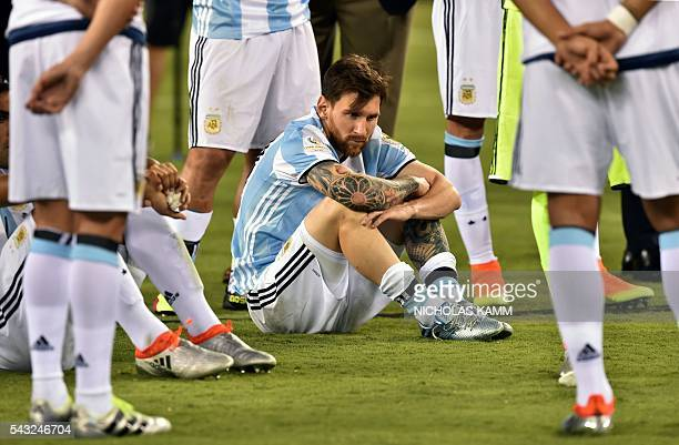 TOPSHOT Argentina's Lionel Messi waits to receive the second place medal during the Copa America Centenario awards ceremony in East Rutherford New...