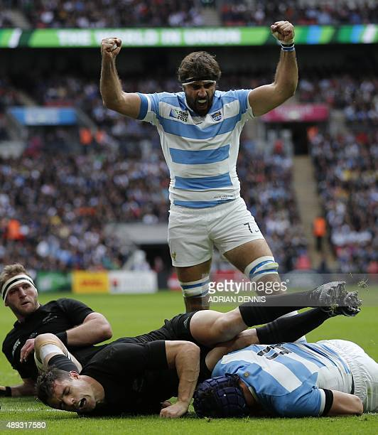 Argentina's lock Guido Petti Pagadizabal scores a try as Argentina's flanker Juan Martin Fernandez Lobbe reacts during a Pool C match of the 2015...