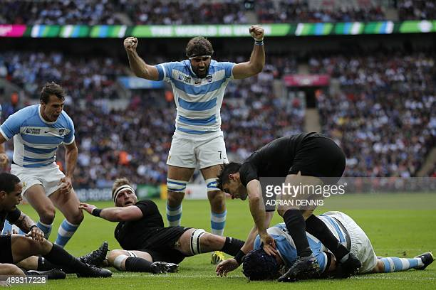 Argentina's lock Guido Petti Pagadizabal scores a try during a Pool C match of the 2015 Rugby World Cup between New Zealand and Argentina at Wembley...