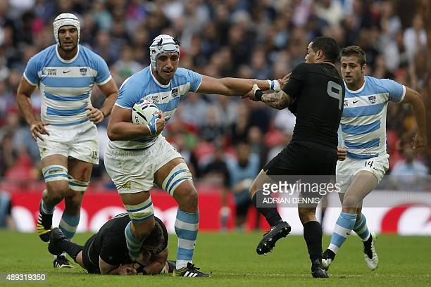 Argentina's lock Tomas Lavanini is blocked by New Zealand's scrum half Aaron Smith during a Pool C match of the 2015 Rugby World Cup between New...