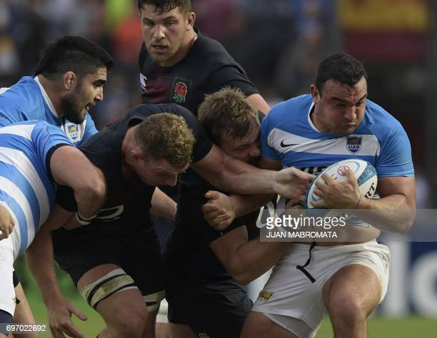 Argentina's Los Pumas hooker Agustin Creevy is tackled by England's prop Matt Mullan and flanker Sam Underhill during their Rugby Union test match at...