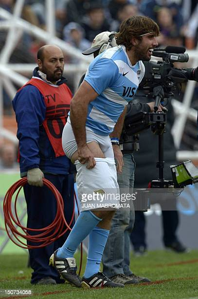 Argentina's Los Pumas number 8 Juan Martin Fernandez Lobbe changes his shorts during the Rugby Championship second round match against South Africa's...