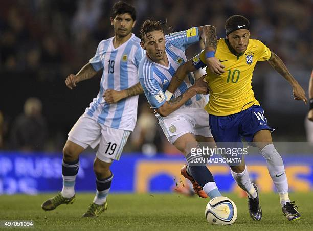 Argentina's Lucas Biglia and Brazil's Neymar Jr vie for the ball during their Russia 2018 FIFA World Cup South American Qualifiers football match in...