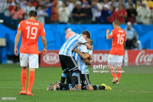 Argentina's Lucas Biglia and Javier Mascherano celebrate victory in the penalty shootout as Netherlands' Klaas Jan Huntelaar and Jordy Clasie are...