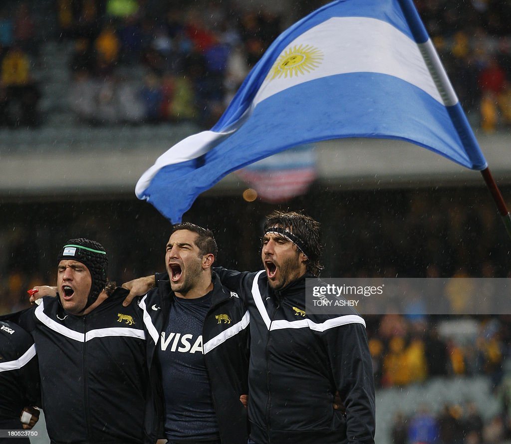Argentina's (L to R) Marcos Ayerza, Juan Manuel Leguizam and captain Juan Martin Fernández Lobbe sing their national anthem before the start of the Rugby Championship Test rugby union match between Australia and Argentina at Paterson Stadium in Perth on September 14, 2013. Australia won 14-13. AFP PHOTO / Tony Ashby USE