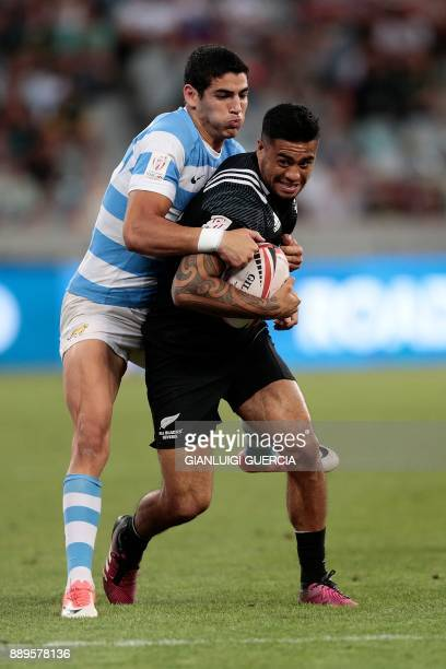 Argentina's Marcos Moroni tackles New Zealand's Regan Ware during the final Argentina vs New Zealand of the World Rugby Sevens Series at Cape Town...