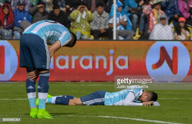 Argentina's Marcos Rojo and Mateo Musacchio react during their 2018 FIFA World Cup qualifier football match in La Paz on March 28 2017 / AFP PHOTO /...