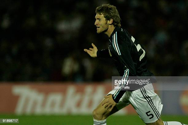 Argentina's Mario Bolatti celebrates scored goal during their FIFA World Cup South Africa2010 qualifier football match at the Centenario Stadium on...