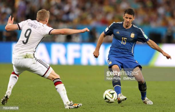 Argentina's Martin Demichelis in action with Germany's Andre Schurrle