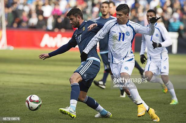 Argentina's Mateo Musacchio vies for the ball against El Salvador's Nelson Bonilla during an international friendly match at FEDEX Field in Landover...