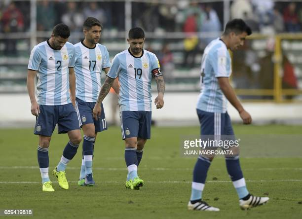 Argentina's Mateo Mussacchio Matias Caruzzo and Ever Banega leave the field after losing their 2018 FIFA World Cup qualifier football match against...