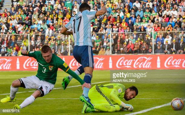 Argentina's Matias Caruzzo and goalkeeper Sergio Romero vie for the ball with Bolivia's Alejandro Chumacero during their 2018 FIFA World Cup...