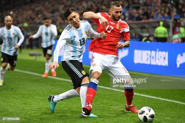 Argentina's Matias Kranevitter and Russia's defender Fedor Kudryashov vie for the ball during an international friendly football match between Russia...