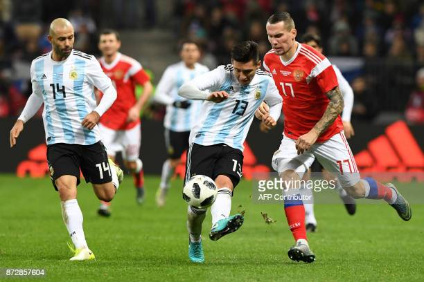 Argentina's Matias Kranevitter and Russia's forward Anton Zabolotny vie for the ball during an international friendly football match between Russia...