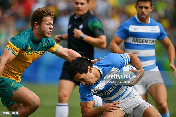 Argentina's Matias Moroni is tackled in the mens rugby sevens match between Argentina and Australia during the Rio 2016 Olympic Games at Deodoro...