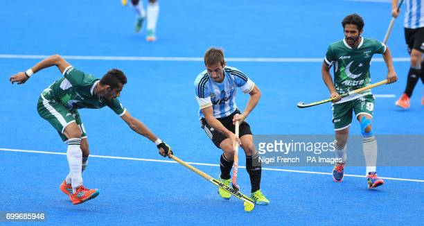 Argentina's Matias Paredes battle for the ball against Pakistan's Ali Shan and Abdul Khan during the Men's World Hockey League match at Lee Valley...