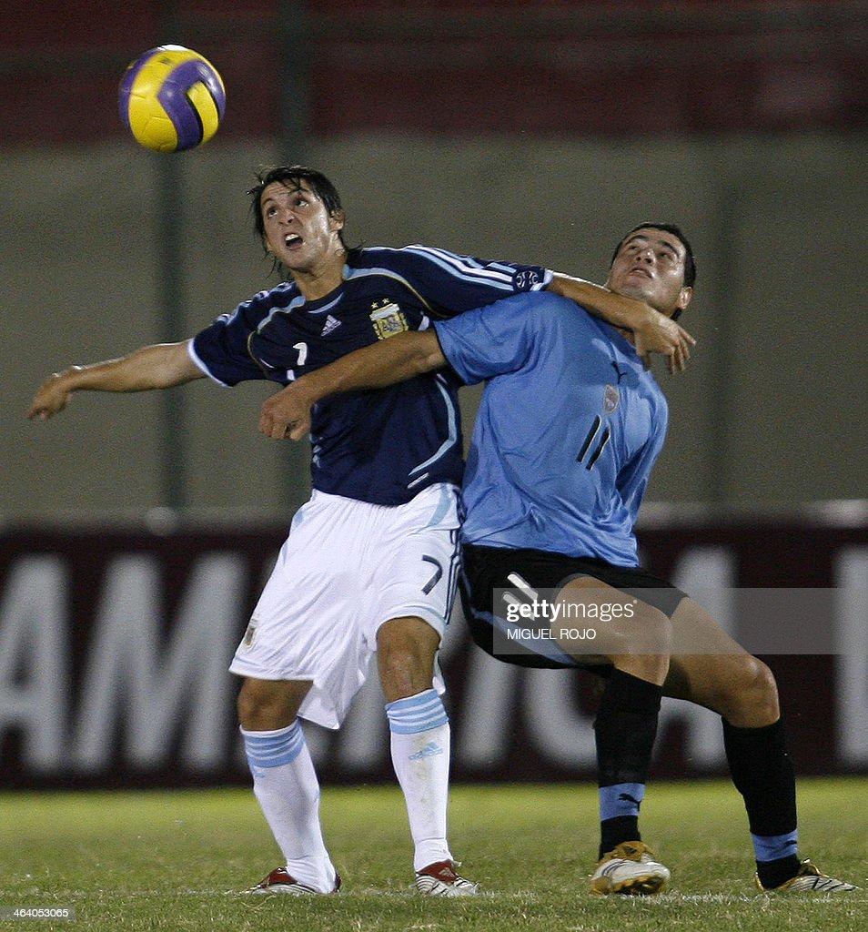 Argentina s Matias Sanchez L vies for the ball with Uruguay s