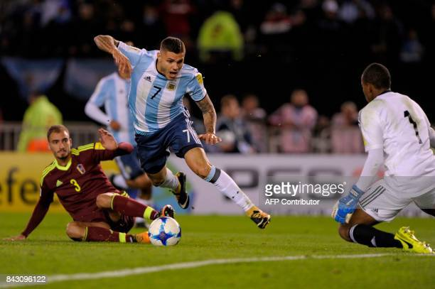 Argentina's Mauro Icardi falls between Venezuela's Mike Villanueva and goalkeeper Wuilker Farinez during their 2018 World Cup qualifier football...