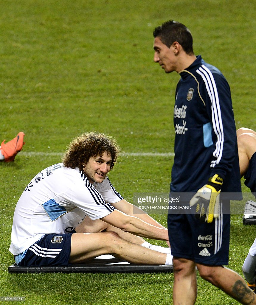 Argentina's midfielder Angel Di Maria (R) and defender Fabricio Coloccini take part in a training session of the Argentina national football team at the 'Friends Arena' in Stockholm, Sweden, on February 4, 2013 two days before the FIFA World Cup 2014 friendly match Sweden vs Argentina.