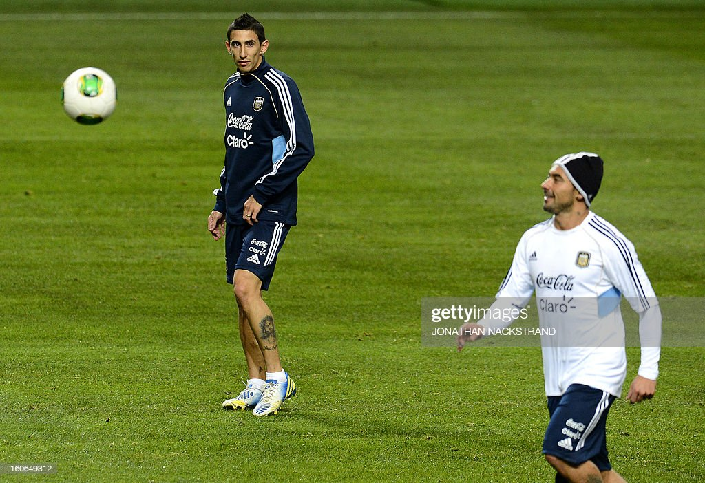 Argentina's midfielder Angel Di Maria (L) and forward Ezequiel Lavezzi take part in a training session of the Argentina national football team at the 'Friends Arena' in Stockholm, Sweden, on February 4, 2013 two days before the FIFA World Cup 2014 friendly match Sweden vs Argentina.