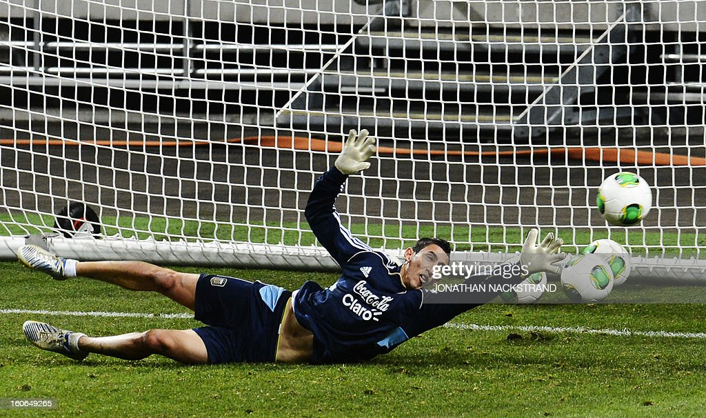 Argentina's midfielder Angel Di Maria stands as a goalkeeper during a training session of the Argentina national football team at the 'Friends Arena' in Stockholm, Sweden, on February 4, 2013 two days before the FIFA World Cup 2014 friendly match Sweden vs Argentina.