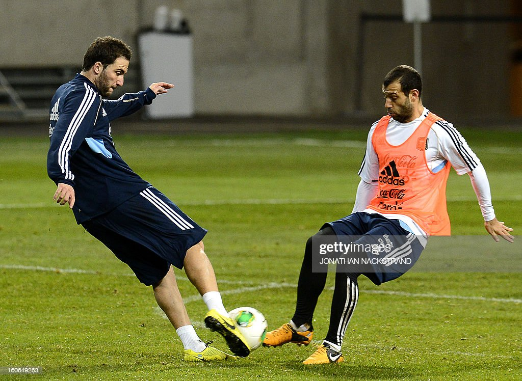 Argentina's Midfielder Javier Mascherano (R) and Forward Gonzalo Higuain take part in a training session of the Argentina national football team at the 'Friends Arena' in Stockholm, Sweden, on February 4, 2013 two days before the FIFA World Cup 2014 friendly match Sweden vs Argentina.