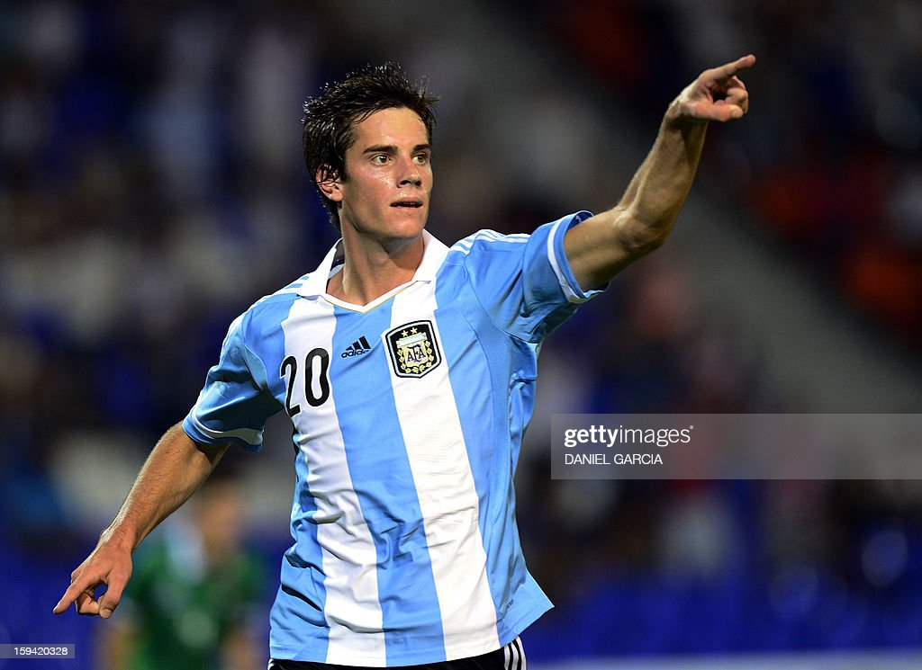 Argentina's midfielder Lucas Melano celebrates after scoring against Bolivia during their Group A South American U-20 qualifier football match at Malvinas Argentinas stadium in Mendoza, Argentina, on January 13, 2013. Four teams will qualify for the FIFA U-20 World Cup Turkey 2013. AFP PHOTO / DANIEL GARCIA