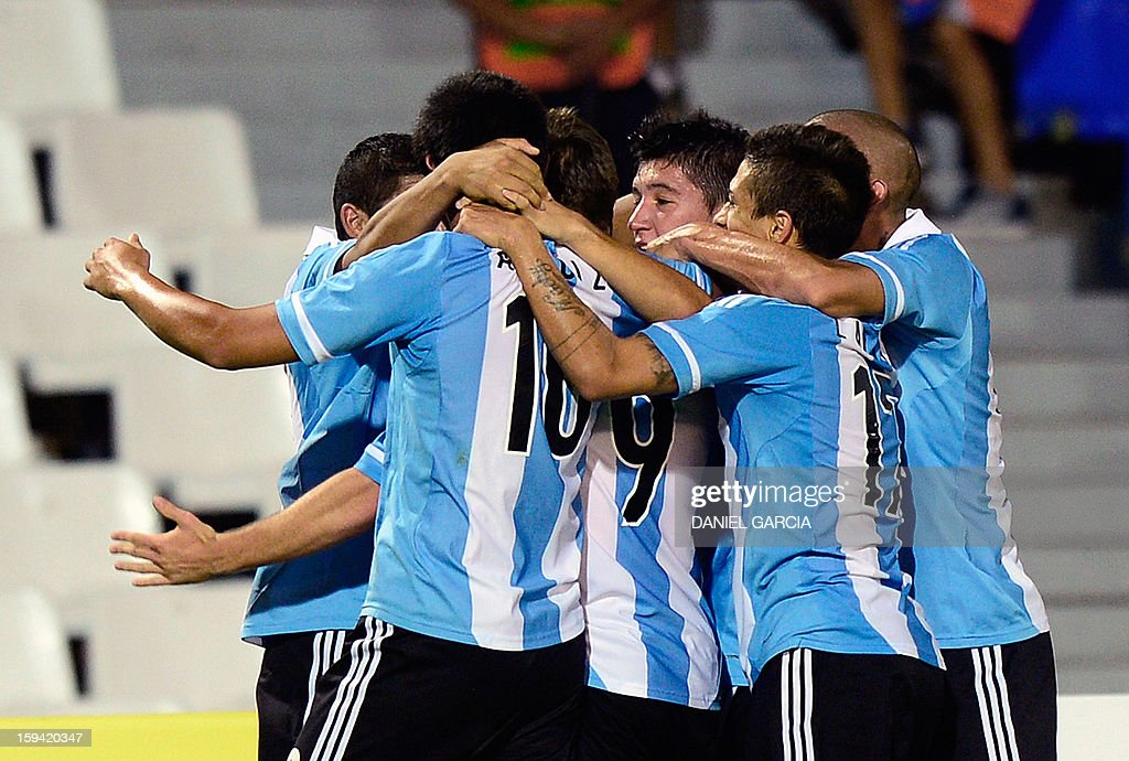 Argentina's midfielder Luciano Vietto (C) celebrates with teammates after scoring against Bolivia during their Group A South American U-20 qualifier football match at Malvinas Argentinas stadium in Mendoza, Argentina, on January 13, 2013. Four teams will qualify for the FIFA U-20 World Cup Turkey 2013.