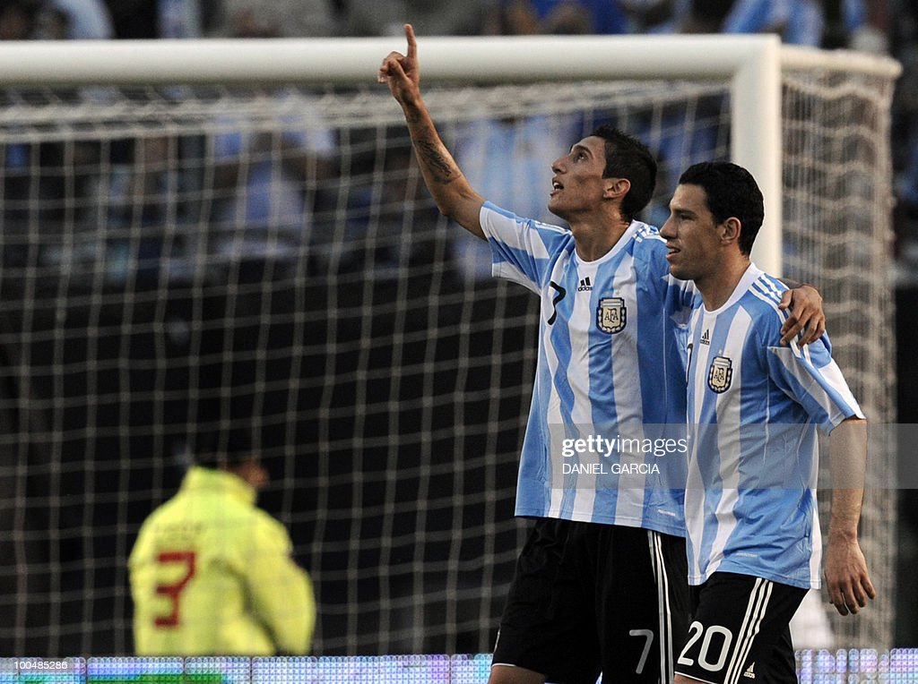 Argentina's midfielder Maximiliano Rodriguez (R) and Angel Di Maria celebrate the third goal against Canada during a friendly football match at the Monumental stadium in Buenos Aires, on May 24, 2010. Argentina is flying to South Africa for the World Cup finals on Friday, and will play their first match against Nigeria on June 12 in Johannesburg. AFP PHOTO/Daniel GARCIA