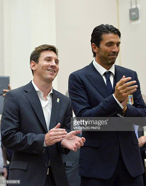 Argentina's national football team forward Lionel Messi and Italy's national football team captain Gianluigi Buffon applaud during a humanity...