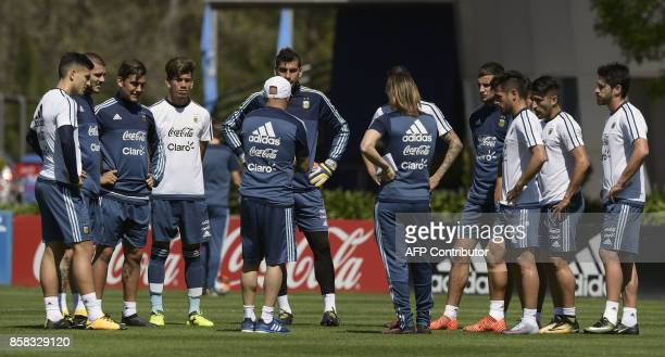 Argentina's national team coach Jorge Sampaoli talks to footballers during a training session in Ezeiza Buenos Aires on October 6 2017 ahead of a...