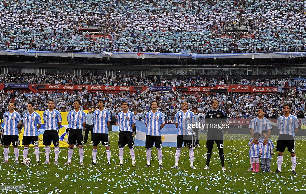 Argentina's national team footballers sing the national anthem before a friendly match against Canada at the Monumental stadium in Buenos Aires, on May 24, 2010. Argentina is flying to South Africa for the World Cup finals on Friday, and will play their first match against Nigeria on June 12 in Johannesburg. AFP PHOTO/Alejandro PAGNI