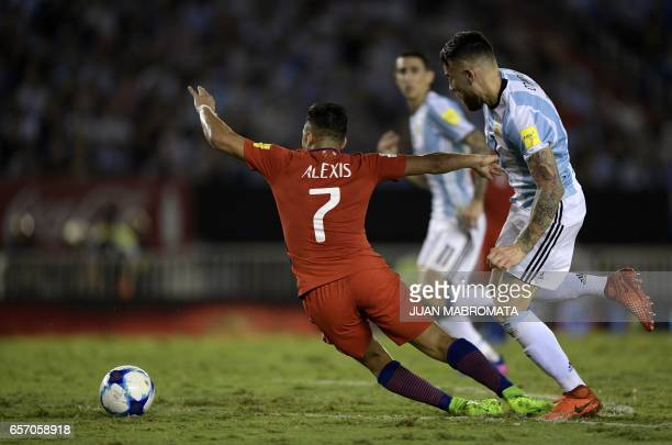 Argentina's Nicolas Otamendi and Chile's forward Alexis Sanchez vie for the ball during their 2018 FIFA World Cup qualifier football match at the...
