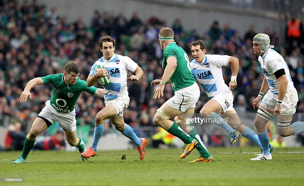 Argentina's Nicolas Sanchez (2ndL) is tackled by Ireland's Gordon D'Arcy (L) and Jamie Heaslip during the Autumn International rugby union match between Ireland and Argentina at the Aviva stadium in Dublin, Ireland on November 24, 2012.