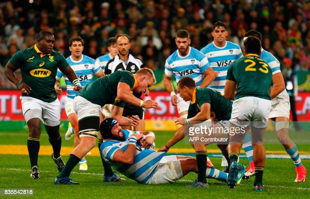 Argentina's number 8 Leonardo Senatore is tackled during the International Rugby Championship Test match between Argentina and South Africa at The...