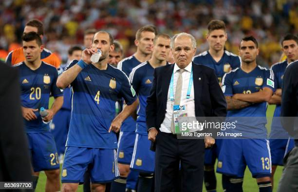 Argentina's Pablo Zabaleta and Argentina manager Alenjandro Sabella appear dejected after the final whistle of the FIFA World Cup Final at the...